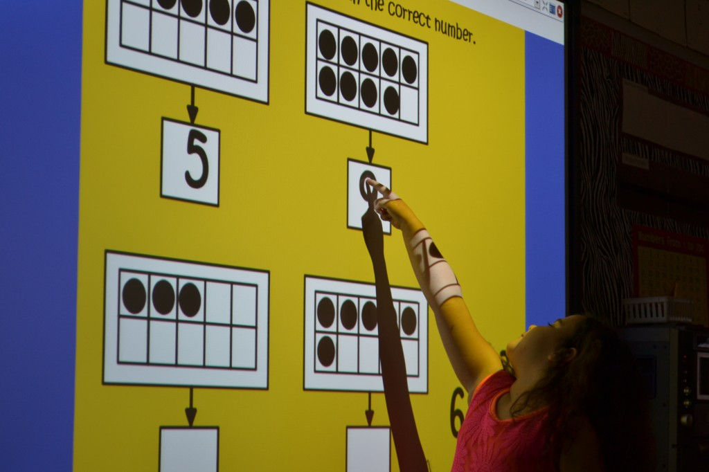 child using smart board