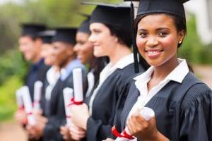 Photo of college graduates with diplomas