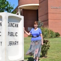 Library director Jan Cole stands in front of Duncan Public Library