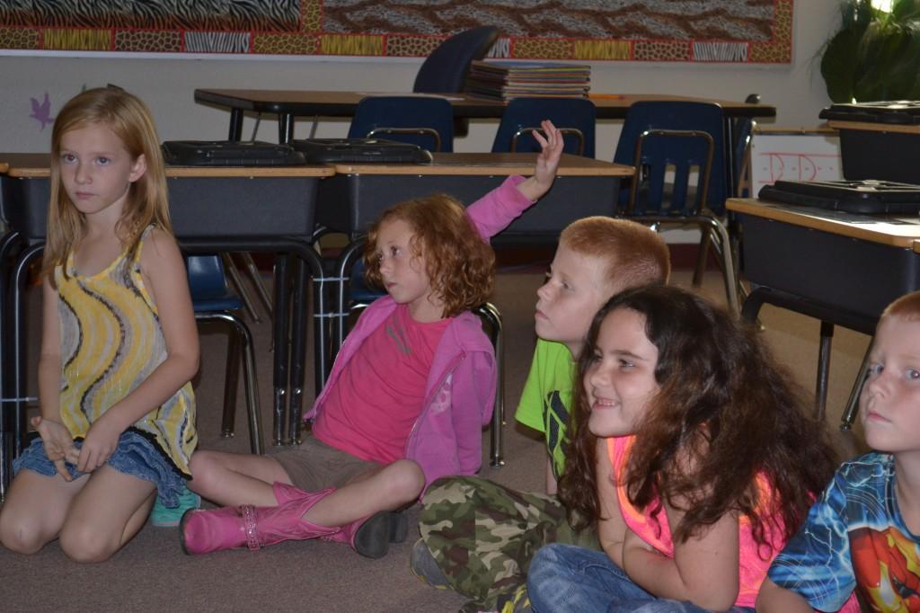 Butner student raising hand in classroom