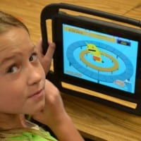 Butner student playing a learning game on a tablet