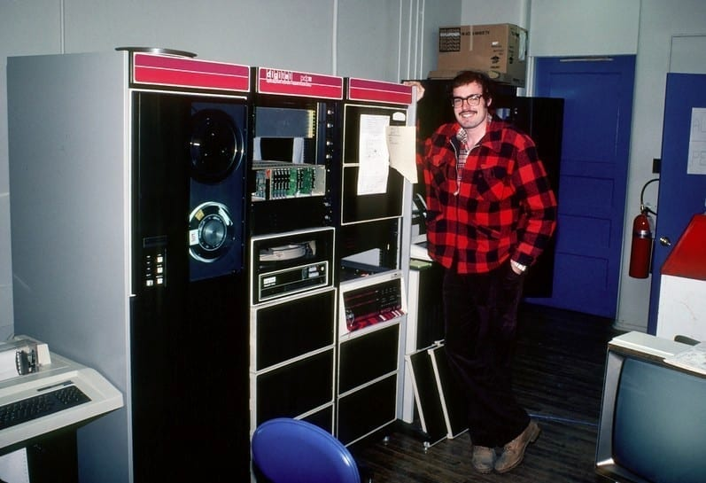 OneNet's Systems Engineer Paul Tibbitts stands next to a fossil. Courtesy of Paul Tibbitts.