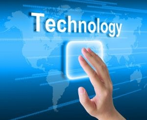 """Hand touching monitor with the word """"Technology"""""""