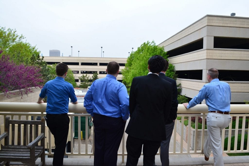 Photo of NOC staff looking over the patio