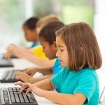 Elementary students working at computers