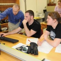 USAO students working on a computer