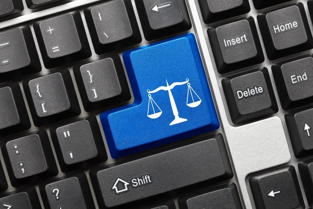 Keyboard with justice scales icon on key