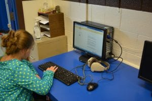 Elementary student using a computer.