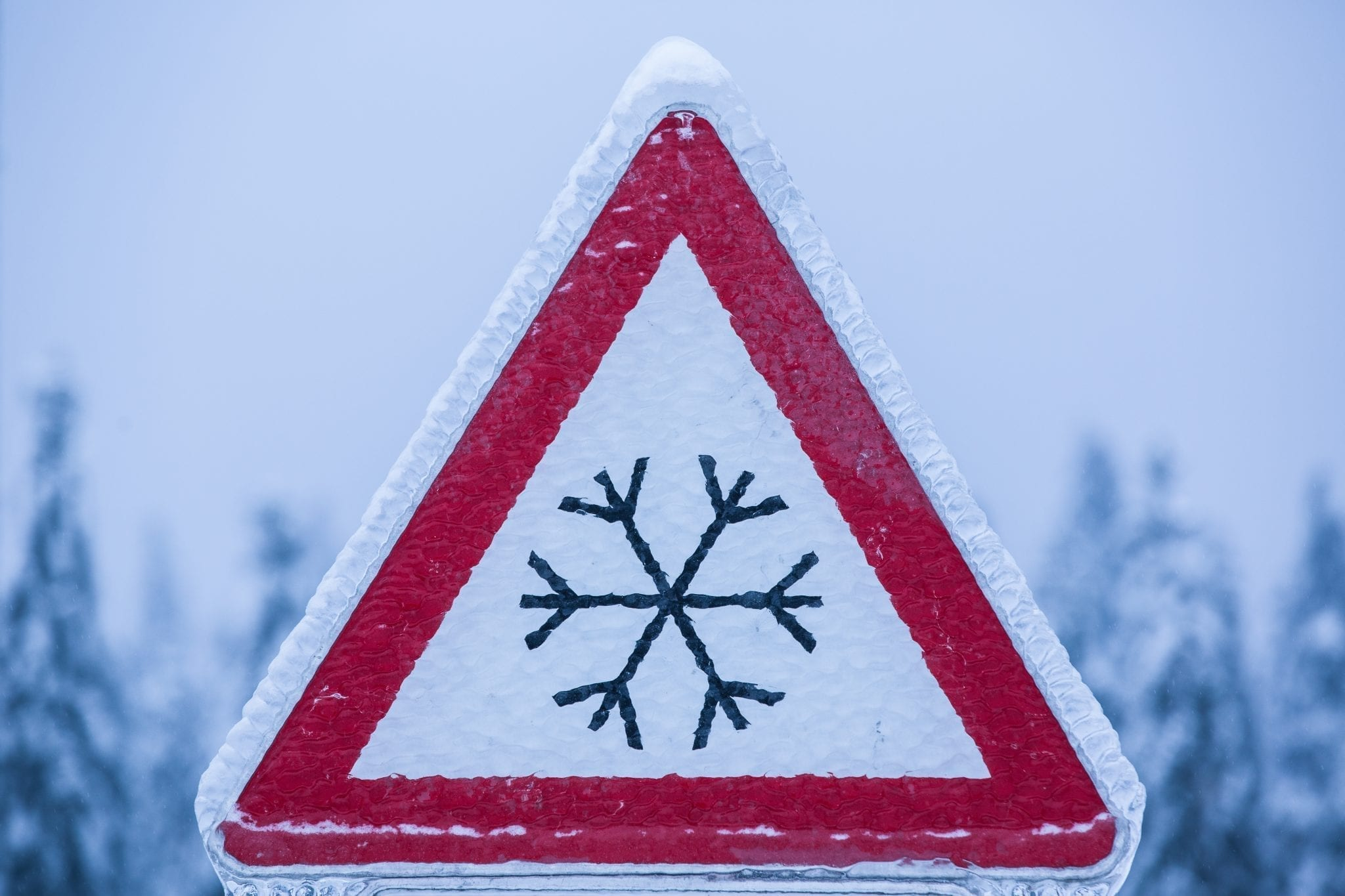 Stock photo of iced over snowflake sign