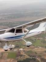 Airplane flies over rural community