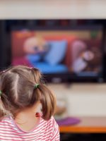 Photo of girl watching TV