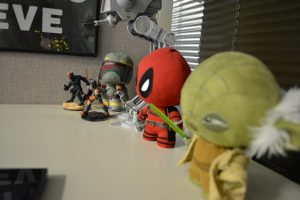 action figures on Arturo's desk