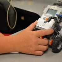 student playing with robot