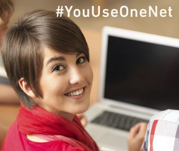 "Student at Computer ""#YouUseOneNet"""