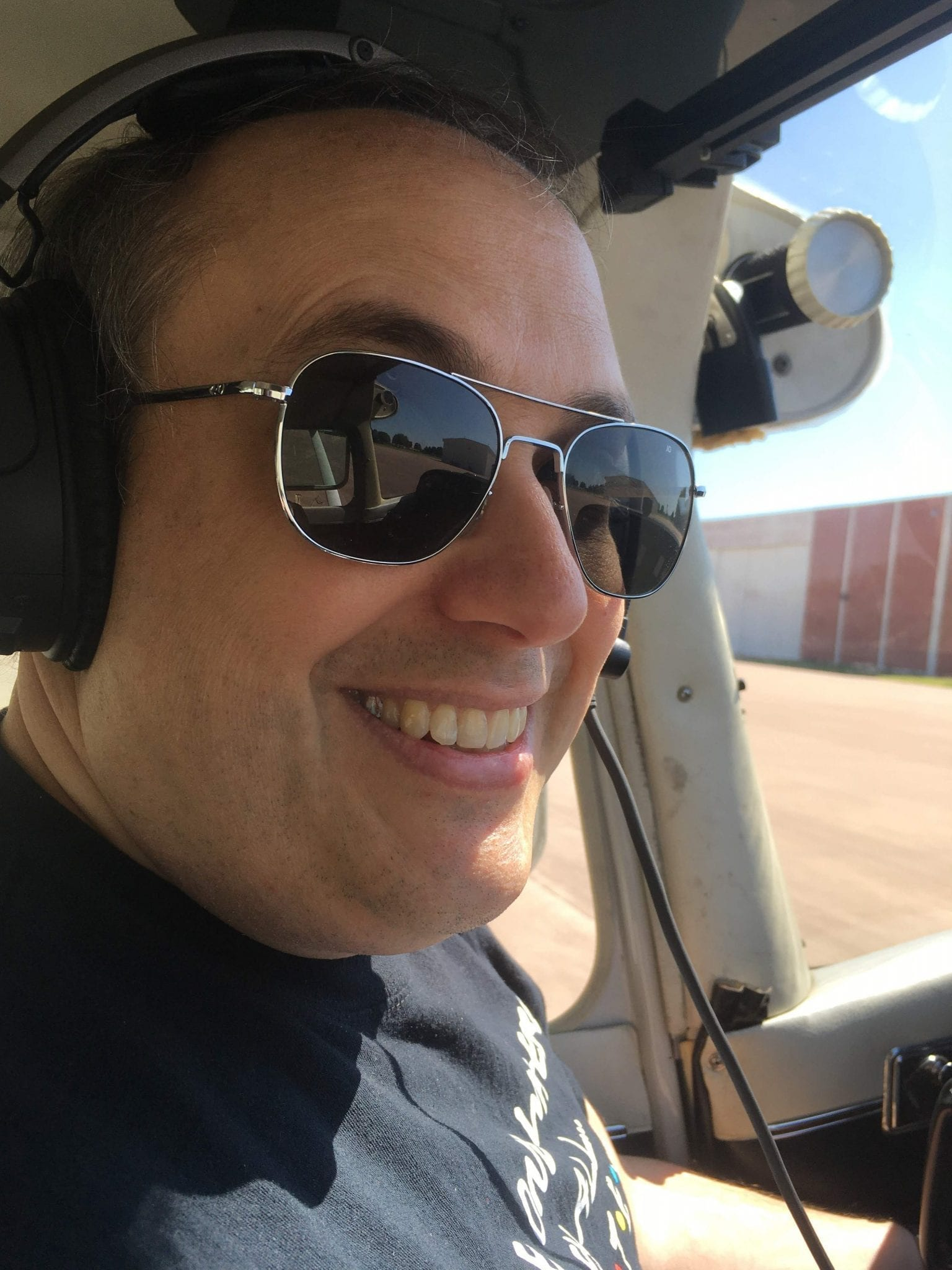 Photo of Brian Burkhart flying an airplane