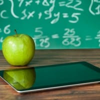 Tablet with green apple