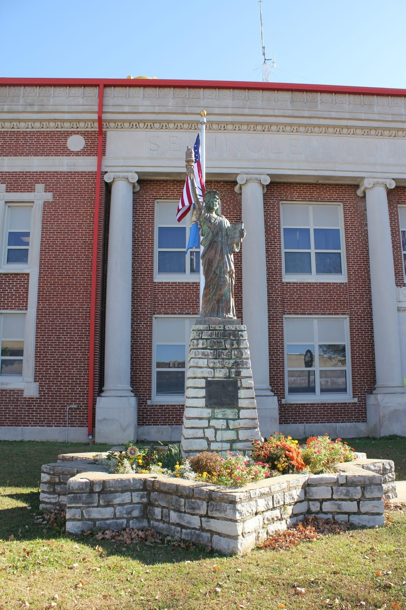 Wewoka Public Schools Building and Statue