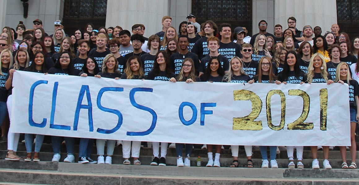 Class of 2021 banner and students