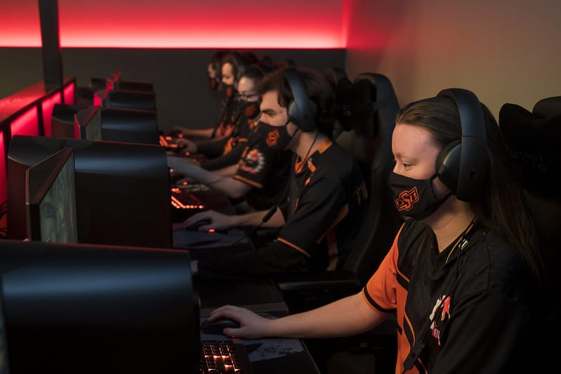 Students playing video games in OSU's esports arena