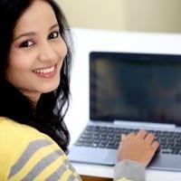 Female Student Using Laptop
