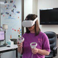 Student using virtual reality headset.